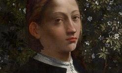Portrait d'une jeune fille devant un décor floral, dont on suppose qu'il s'agit de Lucrèce Borgia. Elle porte des vêtements blancs et noirs et a des cheveux châtains noués à l'arrière et un air sérieux.
