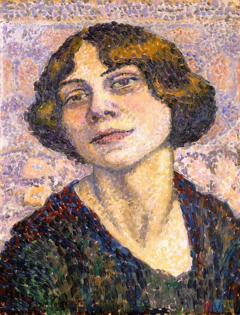 Autoportrait de Lucie Cousturier dans le style pointilliste. Elle porte les cheveux courts et une veste en points rouges, bleus, verts.