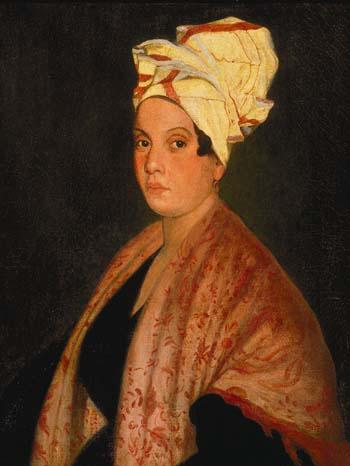 Ce tableau est un portrait de Marie Laveau. Elle est représentée de profil, portant une robe noire, avec un châle à motifs végétaux rouges couvrant ses épaules et un tissu blanc et rouge enveloppant ses cheveux.