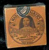 """Cette photographie montre l'emballage d'un produit de la Madam CJ Walker Company. L'emballage orange montre un portrait de Madam CJ Walker, le nom de la compagnie et la mention """"Wonderful Hair Grower"""""""